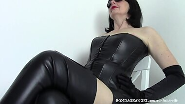 Leather wife in satin gloves shortly after milking husband