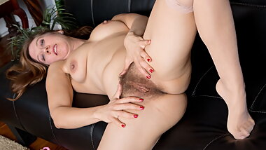 Hairy milf Valentine plays with her cave woman style pussy