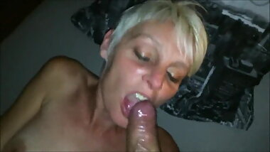Mature blonde with short hair sucking huge nice cock